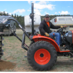 34HP_Kioti_Compact_Tractor_and_Rear_Auger_with_3pt_Bit