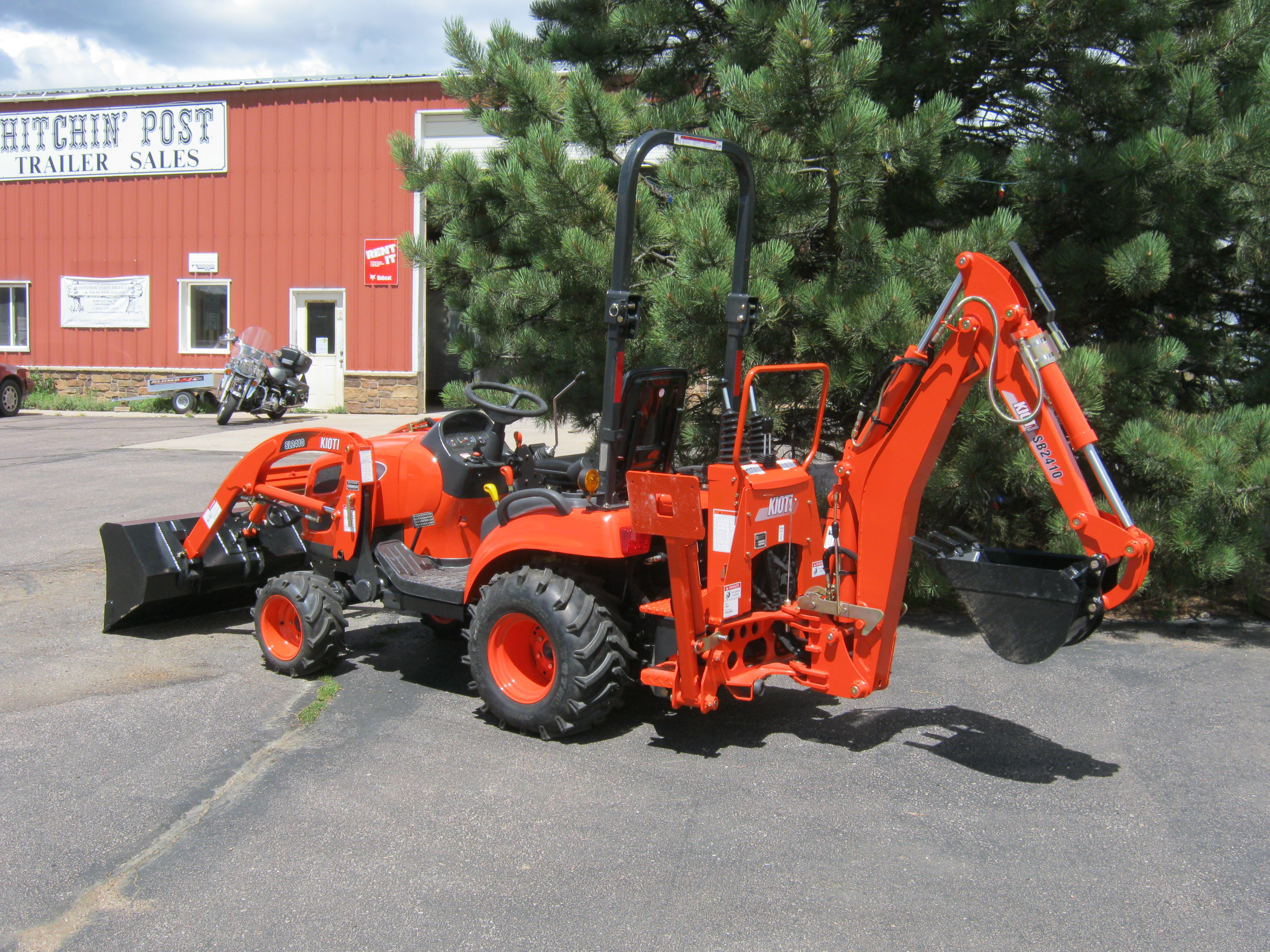 34HP Kioti Compact Tractor and Rear Backhoe